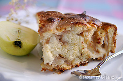Apple-pie piece with half of green apple