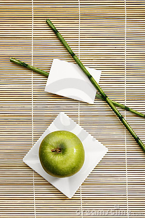 Apple on plate with rattan background decoration