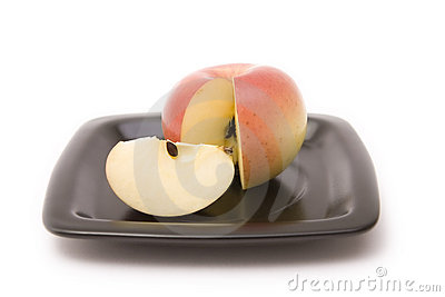 Apple and segment on a plate