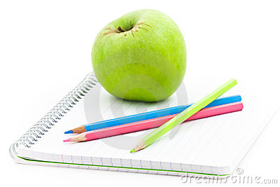 Apple and spiral notebook