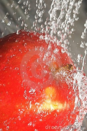 Apple splashing water