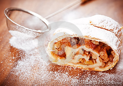 Apple strudel on a wooden board