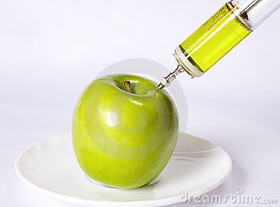Apple with a syringe