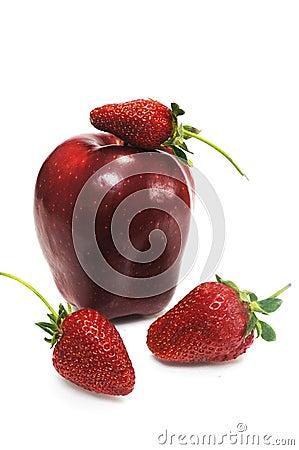 Apple with three ripe strawberry