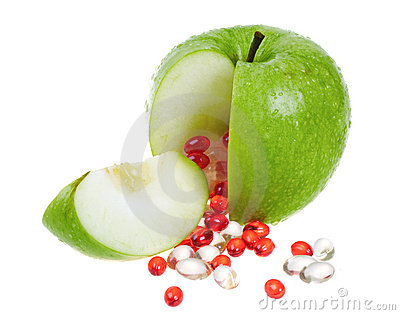 Apple with vitamin capsules
