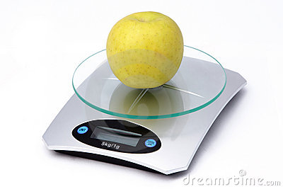 Apple on weighing machine