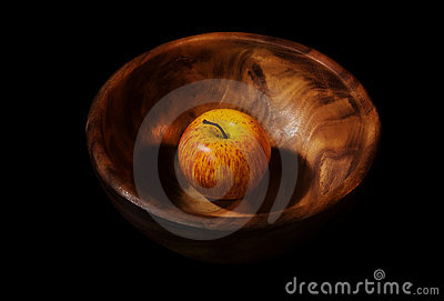 Apple in a wooden dish