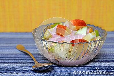 Apple and yogurt in bowl