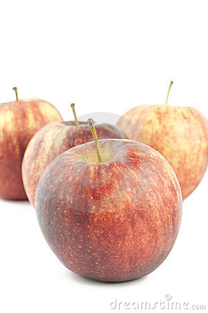 Apples arranged on a white background.