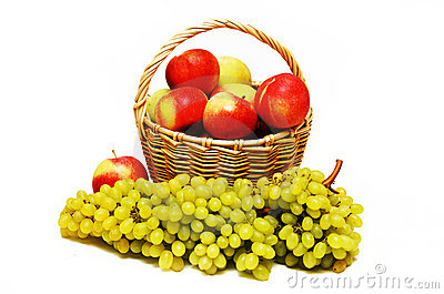 Apples in a basket and grapes in the foreground