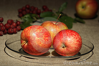 Apples on of-focus textile background.