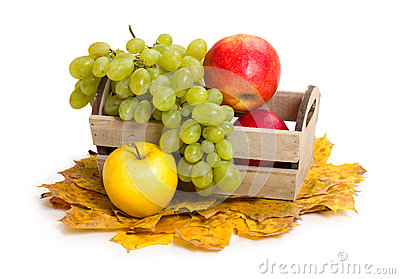 Apples And Grape In Crate On Autumn Leaves Stock Photo - Image ...