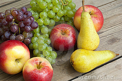 Apples grapes and pears, wooden table