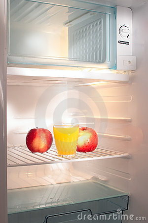 Apples and juice in empty refrigerator