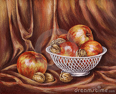 Apples and nuts on a red