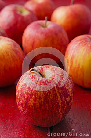 Apples on Red Wood. Vertical