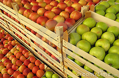 Apples in selling crates on market