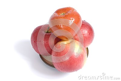 Apples and tomato on a plate
