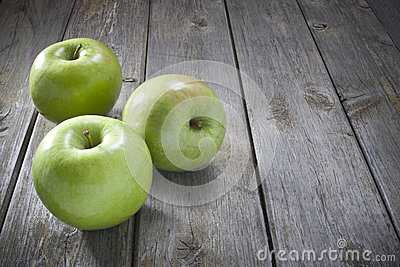 Apples On Wood Background
