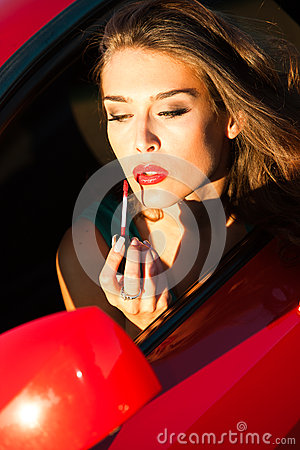 Apply lipstick in car