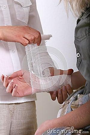 Free Applying A Bandage For Wrist Royalty Free Stock Image - 3283846