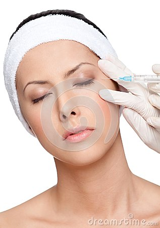 Applying botox eyelid correction