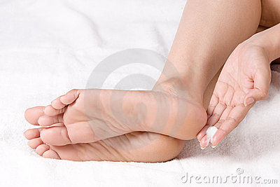 Applying cream to ankle