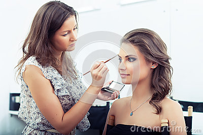 Applying eyebrow make-up