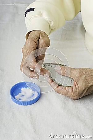 Applying glue to fabric.