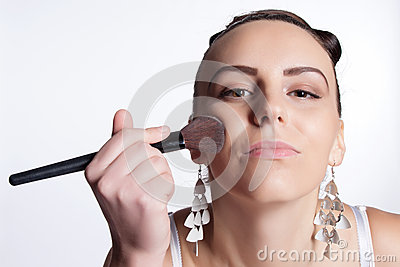 Applying makeup to the face