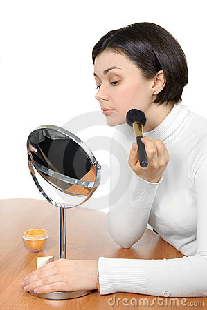 Applying powder using soft brush