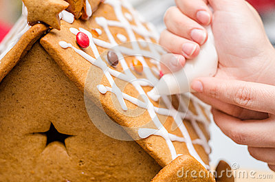 Applying royal icing on gingerbread house