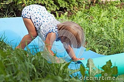 Нappy child on green grass
