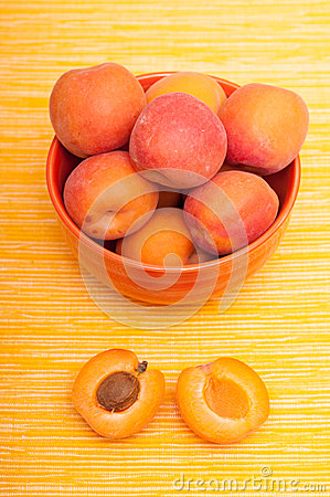 Apricot with apricot kernel beneath a bowl