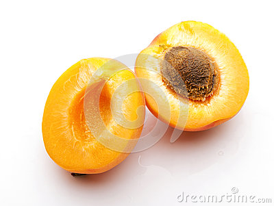 Apricot cutting  in half with stone close-up