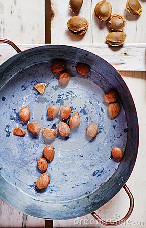 Apricot pits in a copper pot