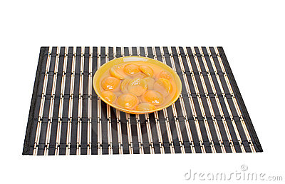 Apricot slices in bowl on placemat