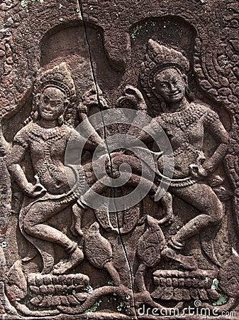 Apsaras dancing on lotuses