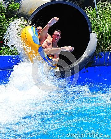Free Aqua Park Fun - Man Enjoying A Water Tube Ride Stock Photography - 25156642
