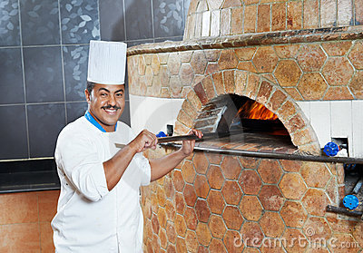 Arab baker chef making Pizza