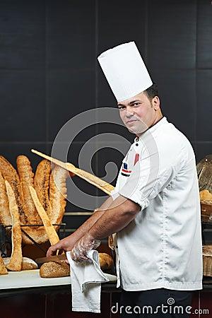 Arab chef cutting bread