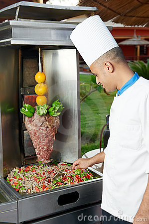 Arab chef making kebab
