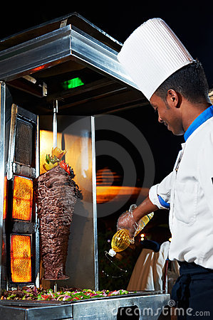 Arab chef making kebab