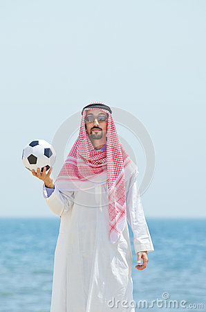 Arab with footbal at seaside