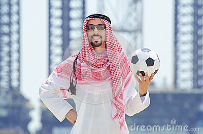Arab with footbal at seaside