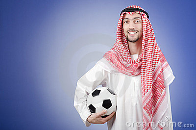 Arab with football in studio shooting
