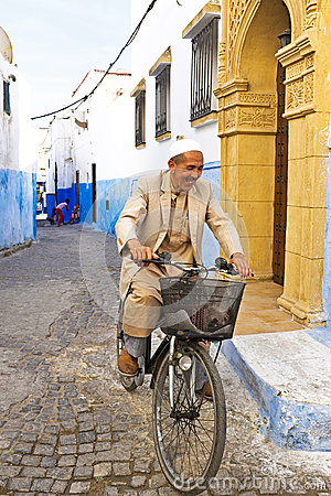 Arab man is biking in Rabat Morocco Editorial Stock Image