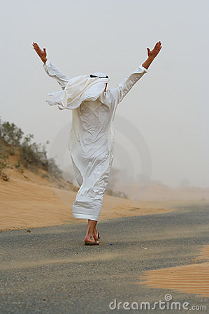 Arab man walking in sand storm