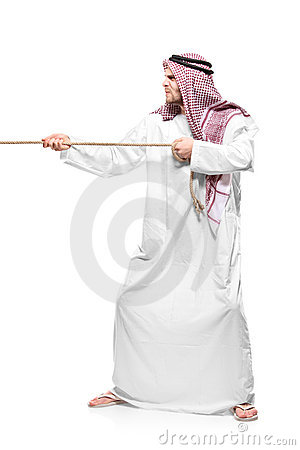 An Arab person pulling a rope