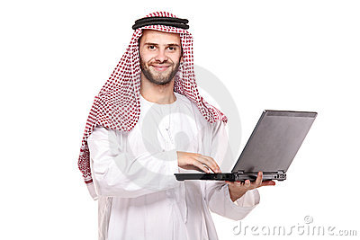 An arab person working on laptop